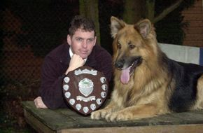 Highly trained protection dogs, UK. Alaster Bly with one of his dogs